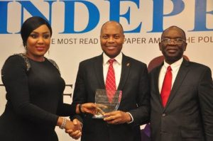 Pix 1, l-r: Director, Independent Newspapers, Adaobi Nwakuche, presenting the award of the Most Innovative Bank won by UBA Plc to the Divisional Head, Digital and Consumer Banking, United Bank for Africa( UBA) Plc, Mr Yinka Adedeji while Managing Director, Independent Newspapers, Mr. Ted Iwere looks on, at the Independent Newspapers Awards, held in Lagos at weekend