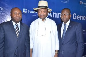 R-L: Company Secretary, Stanbic IBTC Holdings PLC, Mr. Chidi Okezie; Chairman, Mr. Atedo Peterside; and  Chief Executive, Mr. Yinka Sanni; at the 4th  annual general meeting of the company  in Lagos on Tuesday March 7, 2017