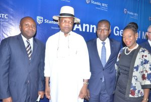 R-L: Company Secretary, Stanbic IBTC Holdings PLC, Mr. Chidi Okezie; Chairman, Mr. Atedo Peterside;  Chief Executive, Mr. Yinka Sanni; and Non-Executive Director, Ngozi Edozien; at the 4th  annual general meeting of the company  in Lagos on Tuesday March 7, 2017.