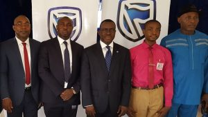 L-R: Head, Commercial Suites, South-East, Stanbic IBTC Bank, Mr. Hillary Nwodo; Regional Manager, South-East; Stanbic IBTC Bank, Mr. Victor  Ekeocha; Chief Executive, Stanbic IBTC Bank, Dr. Demola Sogunle; School Captain, Government College Umuahia, Master Emeku Iheanyi; and The Principal, Government College Umuahia, High-Chief Jerry Onyemachi, during the Financial Literacy Day in celebration in Umuahia on Thursday 30th March, 2017.