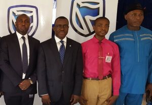 L-R: Regional Manager, South-East; Stanbic IBTC Bank, Mr. Victor  Ekeocha; Chief Executive, Stanbic IBTC Bank, Dr. Demola Sogunle; School Captain, Government College Umuahia, Master Emeku Iheanyi; and The Principal, Government College Umuahia, High-Chief Jerry Onyemachi, during the Financial Literacy Day in celebration in Umuahia on Thursday 30th March, 2017.