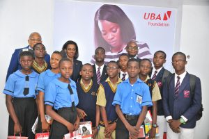 Group Head,  External Relations, UBA Plc, Mr. Nasir Ramon; Director, Marketing and Corporate Relations and Chief Executive Officer, UBA Foundation, Mrs Bola Atta and Deputy CEO, Anglophone Africa, UBA Plc, Ebele Ogbue flanked by students from various schools in Lagos during the Launch of the 2017, UBA Foundation National Essay Competition held at the UBA House in , Lagos on Tuesday