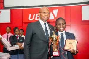L-R: GMD/CEO, United Bank for Africa (UBA)  Plc, Mr. Kennedy Uzoka with the Overall Winner of the 2017 UBA Foundation National Essay Competition and Student of British Nigerian Academy, Miss Samuella Sam-Orlu during the Grand finale and prize giving ceremony of the  UBA Foundation National Essay Competition  held at UBA House in Lagos on Monday