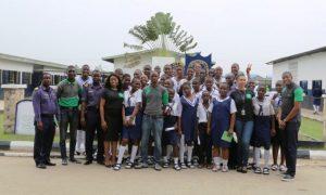 R-L: Timothy Onekutu, Chinenyenwa Ozoemena, Alex Nwogu, Team Members, Financial Literacy, Customer Experience & Analytics, Heritage Bank; Ajiri Efeturi, Team Lead, Financial Literacy, Customer Experience & Analytics, Heritage Bank; Oyeniyi Adenlewo, Experience Centre Associate Retail Banking; Lt. Isah and Lt. Cdr. Godspower Oyibo, Nigerian Navy Seconday School, Ojo with Students of Nigerian Navy Secondary School, Ojo, Lagos at the World Savings Day event held in Lagos