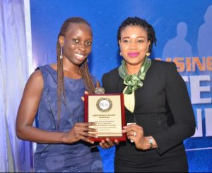 """R-L: Mrs. Cynthia Erigbuem, Group Head, Market Intelligence and Analytics of Heritage Bank presenting award to Mrs Afolayan Eniola, during the Generation Next event, titled, """"Raising Emotionally Intelligent Generation,"""" sponsored by Heritage Bank Plc, in Lagos yesterday"""