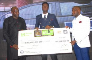 …L-R: Divisional Head, Structured Assets, Heritage Bank, Mr. Kehinde Olugbemi; Winner, The NEXT TITAN NIGERIA Season 4, Mr. Kennedy Iyeh and Divisional Head of Strategy, Heritage Bank Plc, Mr. Segun Akanji, during the star prize presentation of N5 million and a brand-new Ford Ranger to Iyeh, which Heritage Bank was the lead sponsor of the Next Titan Season-4 in Lagos.