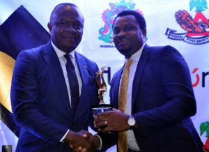 """R-L: Representative of the MD/CEO of Heritage Bank Plc, Ifie Sekibo is the Regional Executive, Abuja & North, George Oko-Oboh receiving the best """"Financial Institution, for Outstanding Support for Tourism"""" award from the MD/CEO of Transcorp Hotel, Mr. Valentine Ozigbo, during National Tourism Transport Summit and Expo Gala Night Award Dinner held at Transcorp Hotel Abuja."""