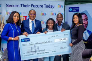L-R: Divisional Head, Marketing & Corporate Communications, Keystone Bank, Mrs. Omobolanle Osotule, Chief Risk Officer, Keystone Bank, Mr. Tijjani Aliyu, Miss Tomisin Ogunnubi, Mr. Yinka Ogunnubi, Head CSR/Sustainability, Keystone Bank, Ms. Izore Bamawo, at the cheque presentation to Miss Tomisin, the ICT Whizkid, in support of her trip to Yale Young Global Scholars Program for outstanding high school students in USA ...recently.
