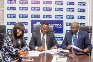 L-R: Mrs. Funke Akindele Bello, Keystone Bank Brand Ambassador, Dr. Obeahon Ohiwerei, GMD/CEO, Keystone Bank Limited, and General Counsel, Keystone Bank Limited, Dr. Michael Agamah during the contract signing of Funke Akindele Bello as Keystone Bank Brand Ambassador, at Keystone Bank Head Office in Lagos recently.