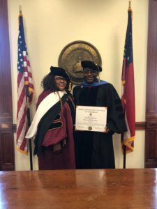 L-R: Her Excellency Rev. Dr. Jacqueline Mohair, Dr. Obeahon Ohiwerei, GMD/CEO  of Keystone Bank Limited as he is conferred with a  Honourary Doctorate Degree from Trinity International University, Georgia in recognition of his sterling achievements