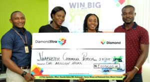 L – R: Peter Ugwoke, Account Officer; Olasunbo Ibekwe, Branch Manager, all of Diamond Bank Plc; Nwabuezeh Patricia, N1million Winner, DiamondXtra Season 10 quarterly draw ; and Nwabuezeh Sixtus, Winner's Husband during the DiamondXtra Season 10 Quarterly draw prize presentation ceremony held in  Lagos recently.