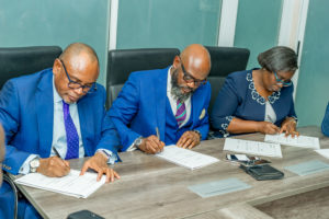 Managing Director FBNQuest Trustees, Mr. Adekunle Awojobi, Lead Partner Desarrollar Group, Mr. Ikemefuna Mordi and Managing Director/CE UTL Trust Management services Mrs Olufunke Aiyepola at the official all Parties signing ceremony between Desarrollar group, a leading Lifestyle and real Estate solutions company and its partners in Lagos recently.