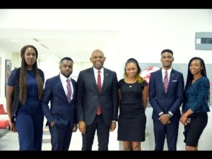 Chairman United Bank for Africa and Heirs Holdings, flanked by young hires at Heirs Place