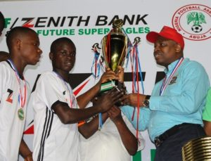 Group Zonal Head, Akwa Ibom, Zenith Bank Plc, Mr. Asuquo Ita,presenting the U-15 trophy to the South-South Team
