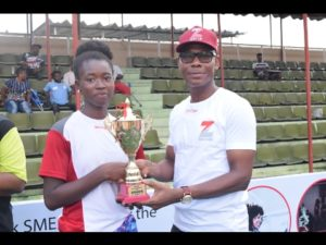 Head, Retail Banking, Zenith Bank Plc, Lanre Oladimeji presenting trophy to the winner of the female category, Omolayo Bamildele at the Zenith Next Gen Tennis competition held at National Stadium.