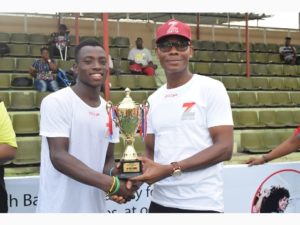 Head, Retail Banking, Zenith Bank Plc, Lanre Oladimeji presenting trophy to the winner of the male category, Musa Mohammed at the Zenith Next Gen Tennis competition held at National Stadium.