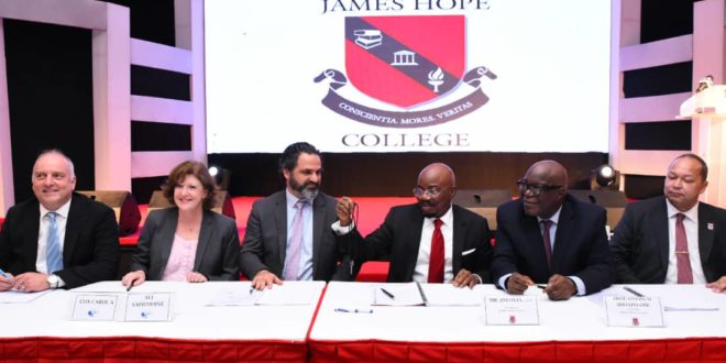 Chairman, Jim Ovia Foundation, Mr. Jim Ovia,CON ( 3rd Left), flanked by His Excellency, the Executive Governor of Lagos, Mr Babajide Sanwo-Olu ( 3rd right); Representative of the American Ambassador to Nigeria, Ms. Carol Cox (1st Left); Chairman, Board of Directors, American International School Lagos (AISL), Mr. Ali Safieddine; Managing Partner, Olaniwun Ajayi, Prof Konyinsola Ajayi, SAN; and Member, Board of Trustees, James Hope College, Prof. Oyewusi Ibidapo Obe, OFR at the signing ceremony of the acquisition of American International School Lagos Property to establish James Hope College Lagos held at the Civic Centre, Victoria Island, Lagos on Wednesday.