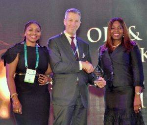Marno de Jong, Vice President, Shell Nigeria (middle) presenting the Oil and Gas Banker of the Year 2019 award won by First Bank of Nigeria Limited to the Bank's Group Executive, Energy & Infrastructure, CBG, Bashirat Odunewu (right) accompanied by Group Head, Corporate Banking Group (Energy), FirstBank, Oluwatoyin Aina (left), at the Patrons' Dinner and Industry Awards of the Nigeria International Petroleum Summit held in Abuja.