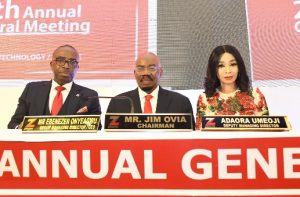 Chairman, Zenith Bank Plc, Mr Jim Ovia (Centre) flanked by the Group Managing Director/ CEO, Mr. Ebenezer Onyeagwu (Left) and the Deputy Managing Director, Dr. Adaora Umeoji (Right) at the 29th Annual General Meeting of the bank held at the Shehu Musa Yaradua Centre, Abuja on Monday, March 16, 2020.