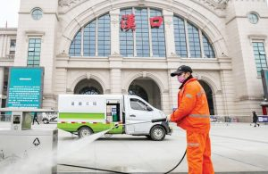 A-public-health-official-disinfecting-some-things-in-Wuhan-China